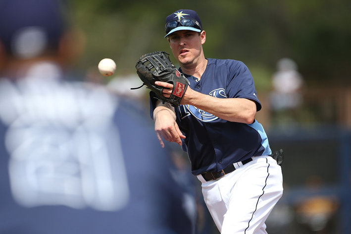 PORT CHARLOTTE, FL - FEBRUARY 23:  Kelly Johnson #2 of the Tampa Bay Rays fields the ground ball and throws to first base during the game against the Pittsburgh Pirates on February 23, 2013 in Port Charlotte, Florida.  (Photo by Leon Halip/Getty Images)