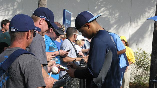 Chris Archer signing autographs during Spring Training. (Photo courtesy of TBO)