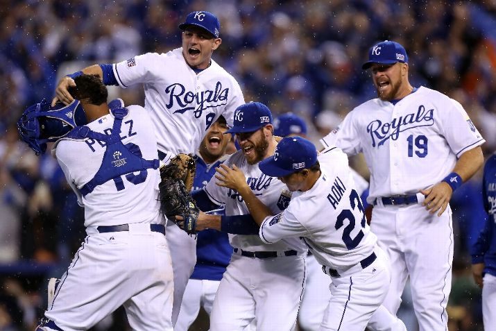 Greg Holland celebrates with Norichika Aoki of the Kansas City Royals after defeated the Los Angeles Angels in Game Three of the American League Division Series. (Photo courtesy of Ed Zurga/Getty Images)