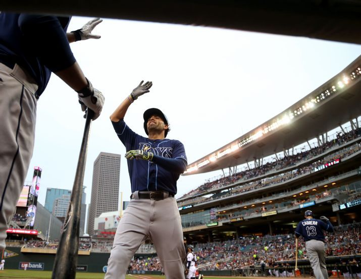 David DeJesus high-fives Joey Butler after hitting a solo home run in the second inning on Friday. (Photo credit: David Joles/Star Tribune via AP)