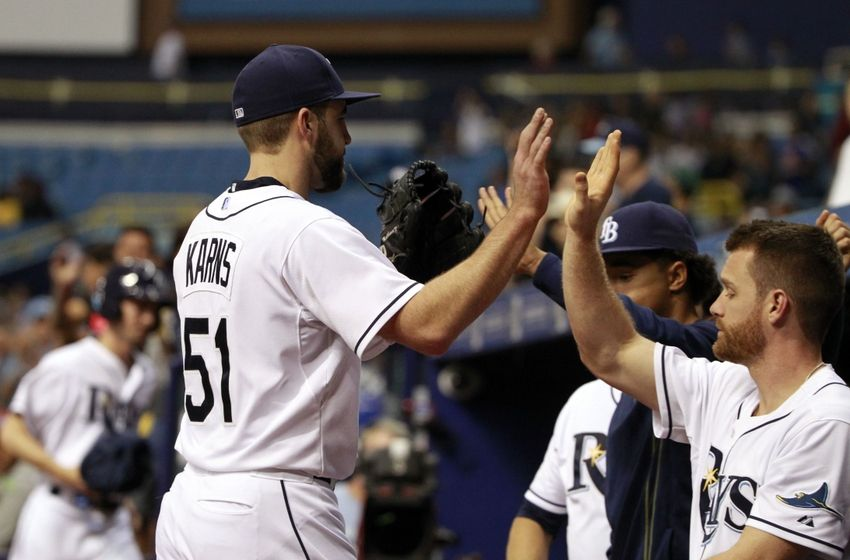 Nathan Karns is congratulated by teammates as he is taken out of the game during the eighth inning against the Texas Rangers at Tropicana Field. (Photo Credit: Kim Klement/USA Today Sports)