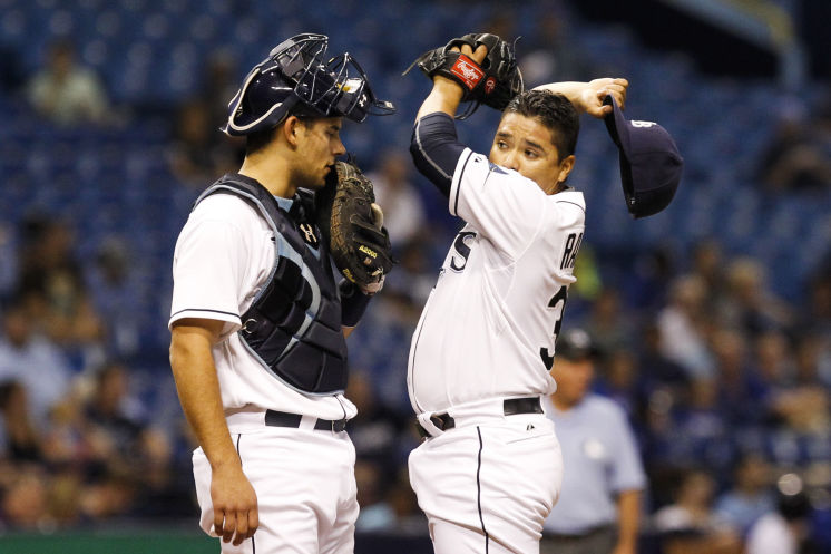 Luke Maile and Erasmo Ramirez make an adjustment in the second inning of the game between the Tampa Bay Rays and the Toronto Blue Jays on Friday. (Photo Credit: Will Vragovic/Tampa Bay Times)