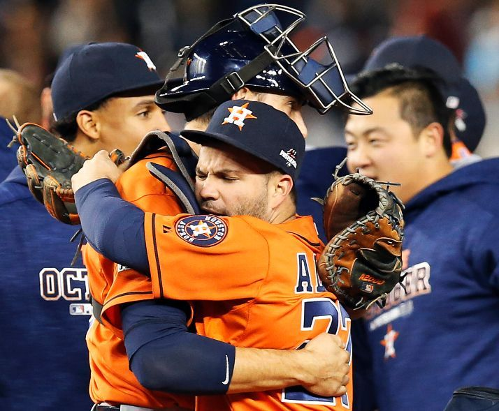 Jason Castro embraces Jose Altuve after the Astros beat the New York Yankees 3-0 in the American League Wildcard game on Tuesday, October 6, 2015. (Photo Credit: AP Photo/Kathy Willens)